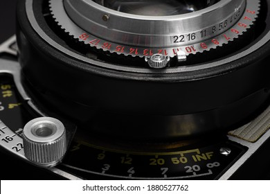 Focus distance scale and aperture ring of old film camera