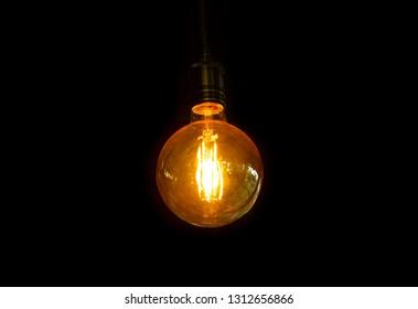 Focus filament lamp on black background