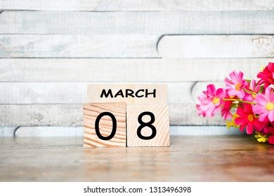 Focus object nature wood block with text and number 08 March and pink flower on wood table and vintage wood background, Woman's day background concept,