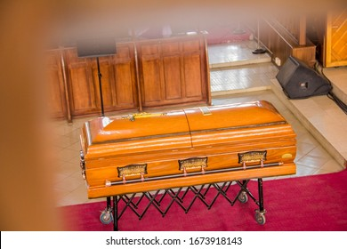 Focus on a casket, the bed of the dead.