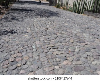 Focus on Cobble road in Mitla city at important archeological site of Zapotec culture in Oaxaca state in Mexico landscapes in 2018 warm sunny winter day, North America on February