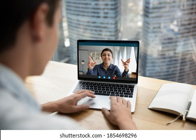 Focus on computer video call application screen happy friendly indian ethnicity businesswoman holding online meeting with colleague, consulting client remotely or mentoring employee distantly.