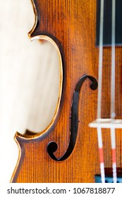 Focus on F hole in violin body belly. Top view