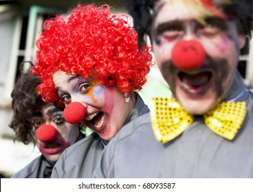 Focus On The Faces Of 3 Crazy Circus Clowns At An Outdoor Birthday Gig Clowning Around In A Funny And Comical Show Of Entertainment
