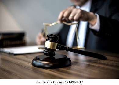 Focus on gavel and scales on the table background Lawyer or judge are discussion  consultation  and advice about law in law firm sepia vintage tone.