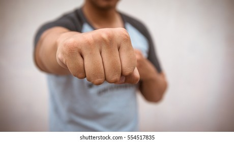 Focus on the hand . Fighting and protect life of man from violent
