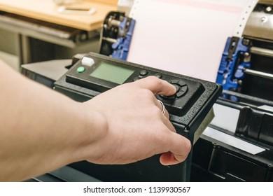 Focus on hand push button on printer