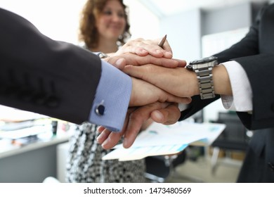 Focus on hands of businesspeople in suit performing friendly gesture of agreement to highly increase efficiency of work. Biz meeting and teamwork concept. Blurred background