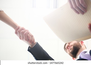 Focus on handshake of woman and man. Business people discussing stipulation of contract and signing important documents. Biz meeting concept. Blurred background
