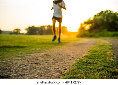 Focus on outdoor cross-country runway in summer sunset concept for exercising, Bokeh filter of runner and bicycle man.fitness and healthy lifestyle.