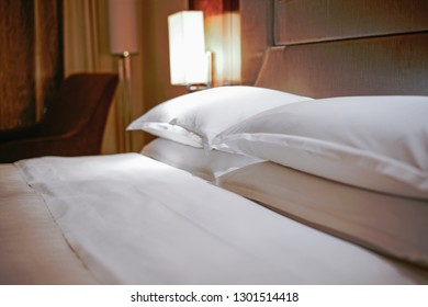 Focus on pillows and quilts, Elegant and comfortable home & hotel bedroom interior.