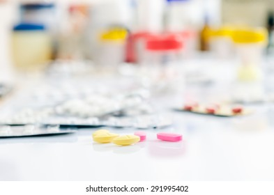 focus on pills with other medicines on background
