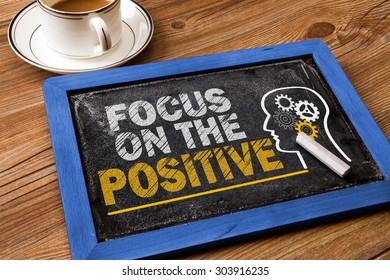 focus on the positive concept on blackboard