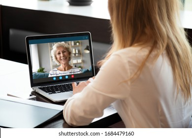 Focus on screen with happy middle aged hoary woman making video call with grown up young daughter woman, chatting communicating online using computer application, staying at home at quarantine.