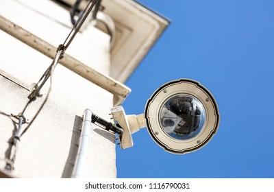 Focus on security CCTV camera or surveillance system on building oin a city