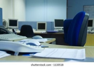 Focus on a single desk in an empty office