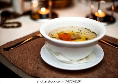 Focus on the soup surface only. transparent meat soup with potatoes, broth, and beef or veal. Shurpa