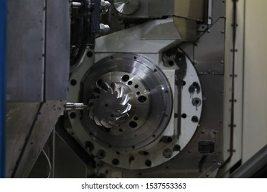Focus on special workshop utility nested into factory and used for making automobile details out of different types of metal. Manual manufacturing process concept