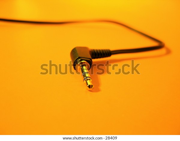 Focus on the tip of a headphone cord.