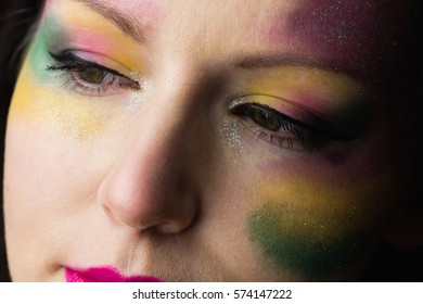 Focus on womans makeup in a studio