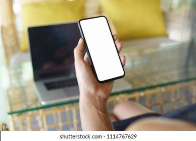 focus on women hand holding phone white screen