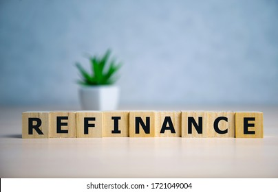 focus on wooden blocks with letters Refinance text. Concept image.