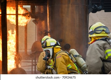 Focus sits on the firefighter in the middle between the two others.
