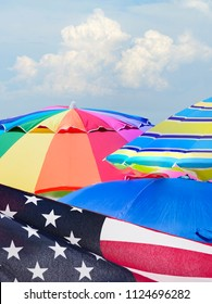 Focus Stacked 4th of July Celebration on a Florida Beach including American Flag Beach Umbellas and Clouds