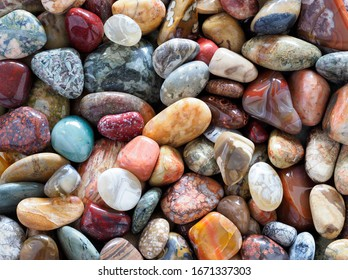 Focus Stacked Image of a Collection of Tumbled or Polished Stones to Include Agates, Petified Wood and Semi Precious Stones