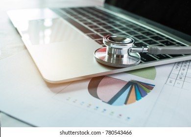 Focus Stethoscope Doctor table on laptop computer with report analysis and money about Healthcare costs and fees in medical hostpital office. Healthcare budget and business concept