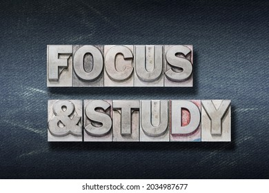 focus and study phrase made from metallic letterpress on dark jeans background