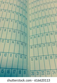Focus vintage numbers on old paper calendar concept