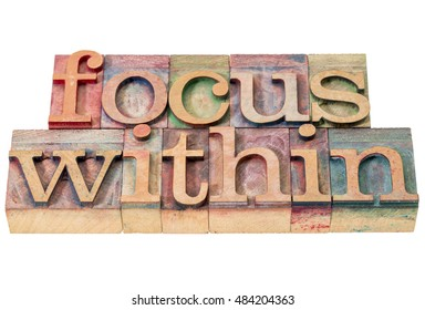focus within word abstract - isolated text in letterpress wood type printing blocks stained by color inks