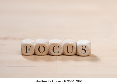 Focus word on wooden cubes. Focus concept