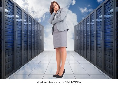 Focused businesswoman against server hallway in the sky