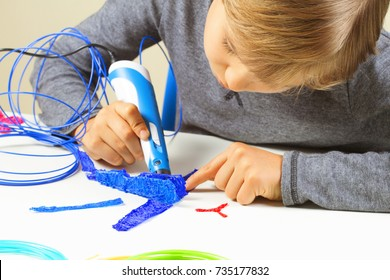 Focused child creating new 3d object with 3d printing pen.