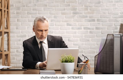 Focused entrepreneur writing an email