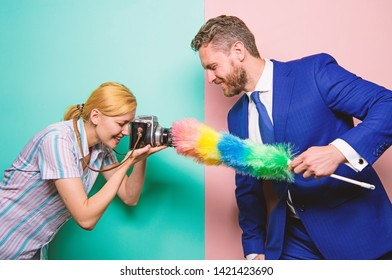 Focused on dust. Attentive reporter capture dirty reportage. Too much attention detail. Shooting through clean camera lens. Wipe dust. Picky and curious. Girl photographer capture every tiny dust.