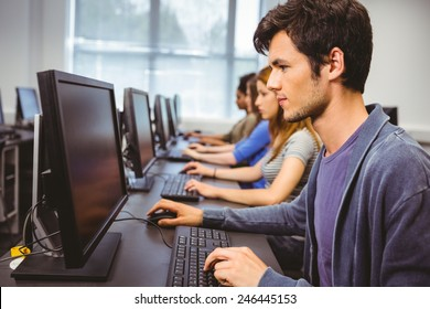 Focused student in computer class at the university