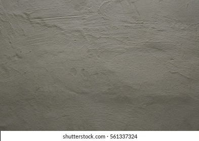 Focused texture of grainy noisy grey wall