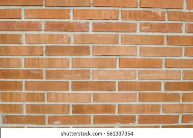 Focused texture of orange solid brick wall