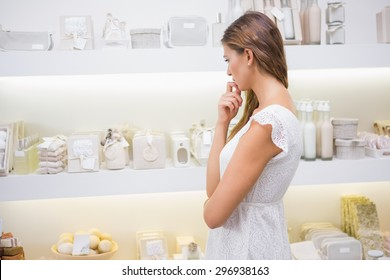 Focused woman browsing products at a beauty salon