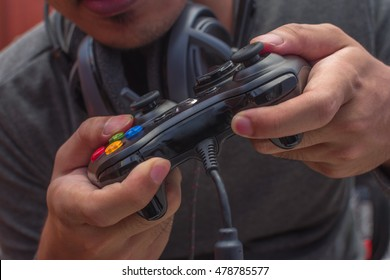 Focused young gamer playing games using his controller.