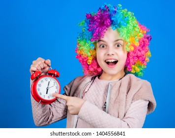 Focusing on accuracy. Happy small child pointing at alarm clock. Little girl smiling with clock. Accuracy and neatness. Perfect time accuracy. Accuracy concept.