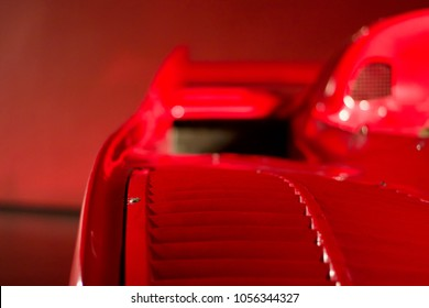 Focusing on the interior of a Ferrari red supercar on a red background