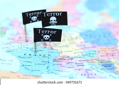 Focusing on three Terror warning flags over France, Belgium and England (Great Britain) on a map of Europe - illustration image. Selective focus. One flag is out of focus. Side view