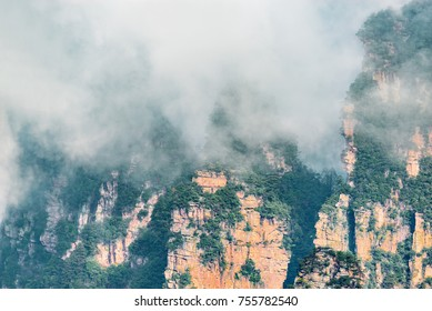 Fog above the cliffs in Zhangjiajie Forest Park. China.