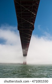 Fog begins to roll in to San Francisco Bay and cover the Golden Gate Bridge in California. This iconic structure connects the beautiful city of San Francisco and the scenic Marin Headlands.