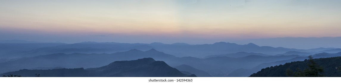 fog between the Ligurian mountains at sunset