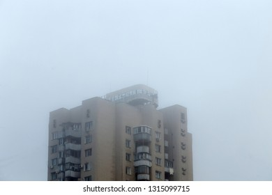 Fog in the city. A lonely house in the fog.